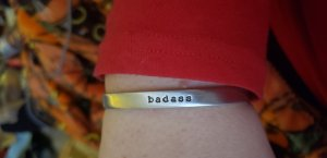 Amazing bracelet I bought from CynicalRedhead on Etsy that says badass.